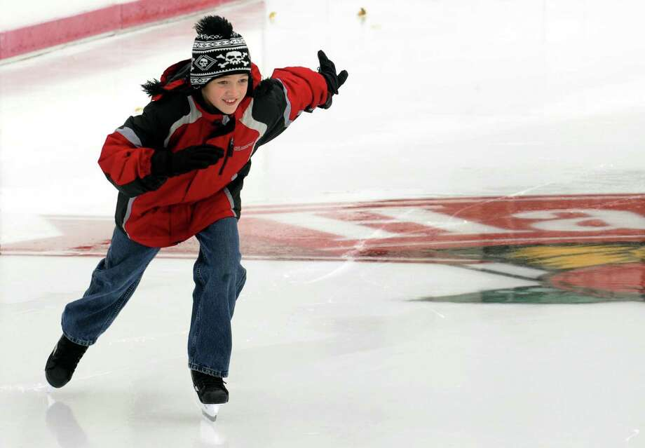 Ten-year-old Brandon Henges of Colonie speeds across the ice on opening day at the Empire State Plaza ice rink in Albany, NY, on Friday, Nov. 23, 2012. (Michael P. Farrell/Times Union) Photo: Michael P. Farrell