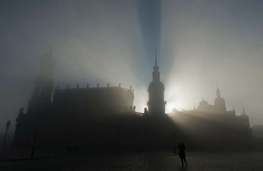 Heavy fog envelops the Hofkirche, a.k.a. the Sanctissimae Trinitatis Catholic Church of the Royal Court of Saxony, in Dresden, Germany. Photo: Robert Michael, AFP/Getty Images