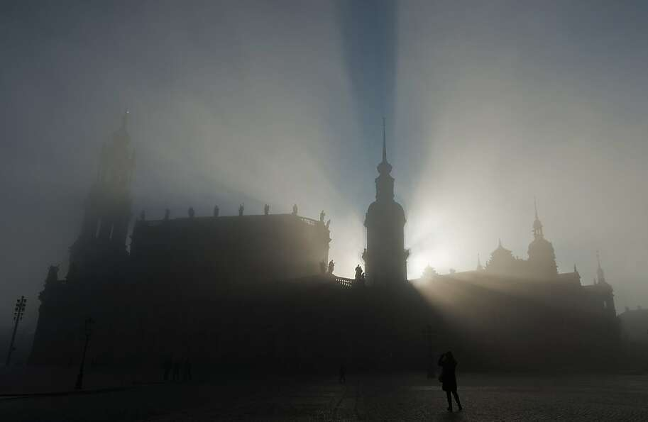 Heavy fog envelops the Hofkirche, a.k.a. the Sanctissimae Trinitatis Catholic Church o