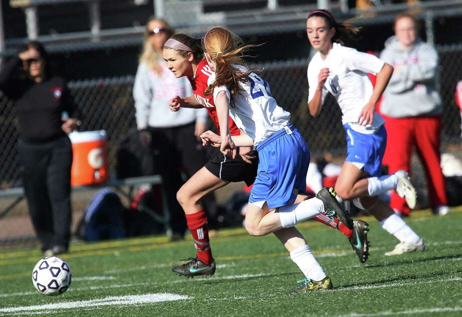 Mike Ross Connecticut Post freelance -Masuk High School's # 13 Michelle Andrzejewski makes her way through Avon High School defense during the first half Class L Soccer Finals on Friday afternoon. Photo: Mike Ross / Connecticut Post Freelance