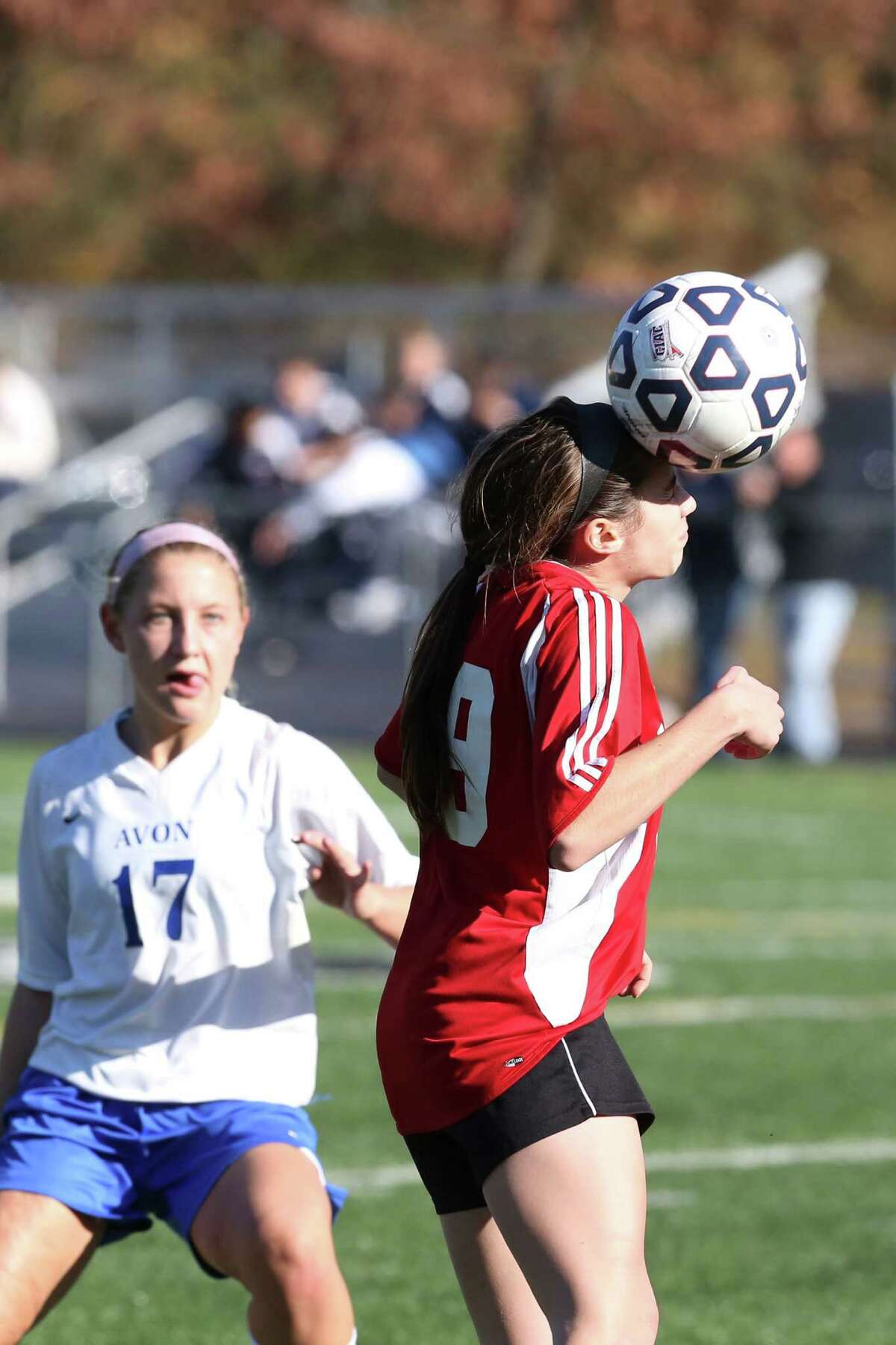 Mike Ross Connecticut Post freelance -Masuk High School's # 9 Hayley Lazar heads a ball from teammamte during Friday afternoon during the first half Class L Soccer Finals against Avon High School. Avon would win 1-0.