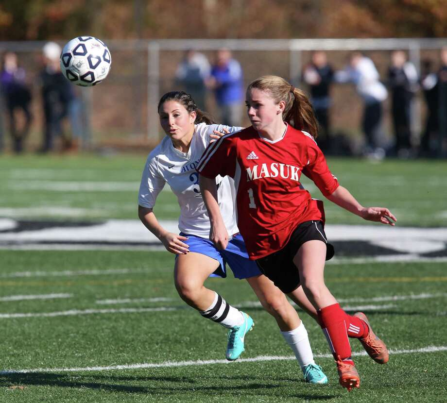 Mike Ross Connecticut Post freelance -Masuk High School's # 1 Jaime Madden battles for the ball against  Avon High School's # 3 Sarah Betancourt  during the second half of the Class L Soccer Finals on Friday afternoon. Avon would win 1-0. Photo: Mike Ross / Connecticut Post Freelance