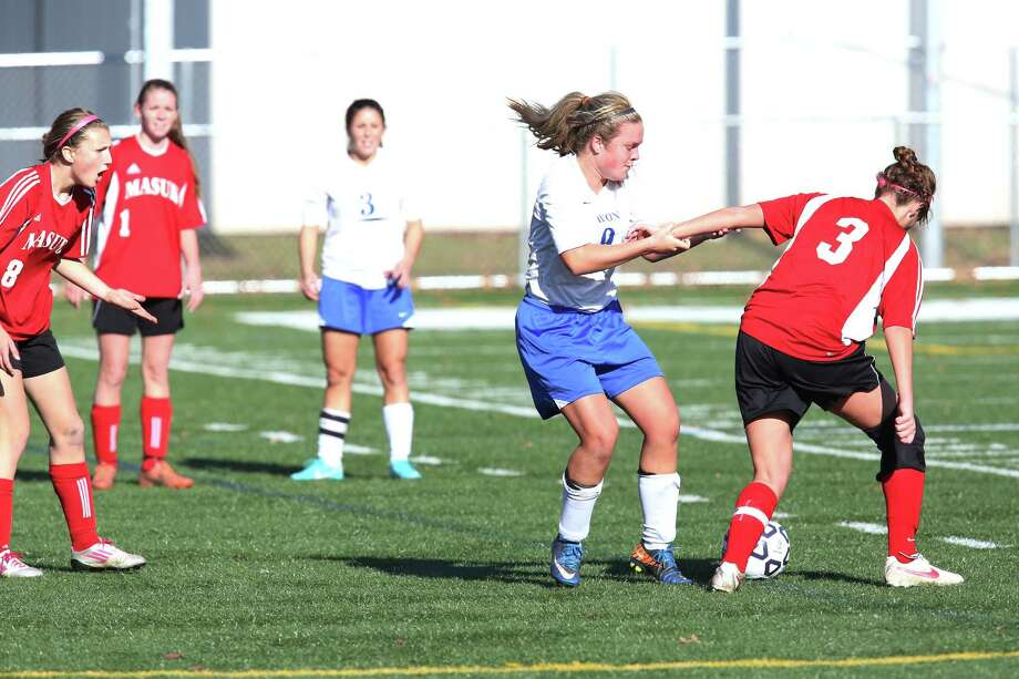 Mike Ross Connecticut Post freelance -Masuk High School's # 3 Emily Montgomery gets fouled from Avon High School's #9 Britt Douglas during Friday's  Class L Soccer Finals on Friday afternoon. Photo: Mike Ross / Connecticut Post Freelance