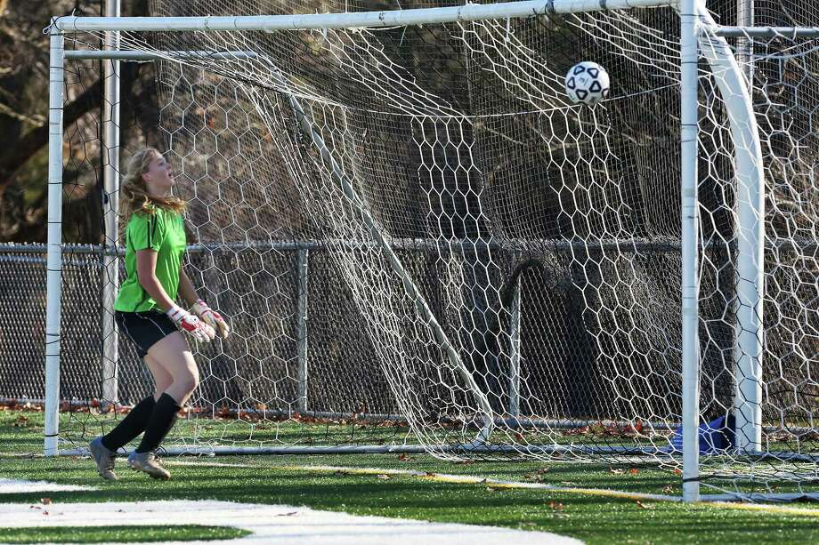 Mike Ross Connecticut Post freelance -Masuk High School's goalie Megan Fitzgerald watches the ball enter the goal for an score from Avon High School player # 3 Sarah Betancourt during the final thirtteen minutes of Friday's Class L Soccer Finals. Avon would won 1-0. Photo: Mike Ross / Connecticut Post Freelance