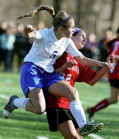 Mike Ross Connecticut Post freelance -Masuk High School's # 22 Dana Antenucci battles heavy preasure from Avon High School's # 5 Erin Heston during Friday's Class L Soccer Finals held at Falcon Field in Meriden. Avon would win 1-0. Photo: Mike Ross / Connecticut Post Freelance