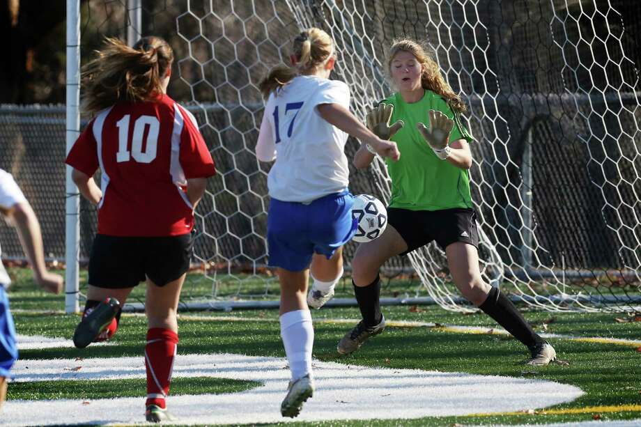 Mike Ross Connecticut Post freelance -Masuk High School's goalie Megan Fitzgerald makes a save off the foot of Avon High School's # 17 Lauren Miller during Friday's Class L Soccer Finals. Avon would won 1-0. Photo: Mike Ross / Connecticut Post Freelance