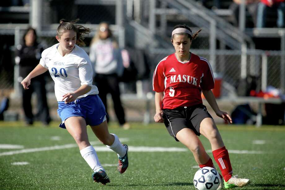 Mike Ross Connecticut Post freelance -Masuk High School's # 5 Nicole Yanouzas moves the ball against Avon High School's #20 Michaela Sheppard during Friday's Class L Soccer Finals held at Falcon Field in Meriden. Avon would win 1-0. Photo: Mike Ross / Connecticut Post Freelance