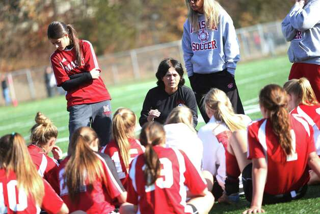 Mike Ross Connecticut Post freelance -Masuk High School's head coach Eleanor Brainard goes over game plan with players during halftime break for Friday's Class L Soccer Finals against Avon High School. Photo: Mike Ross / Connecticut Post Freelance
