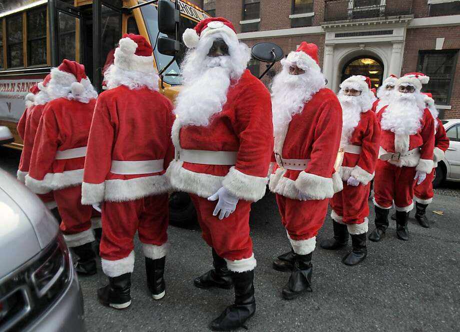 Now that Hostess has closed down, America must find its Ho-Hos somewhere else -- the annual Sidewalk Santa Parade in New York, for example. Always a lot of ho-ho-ho-ing going on here. Photo: Richard Drew, Associated Press