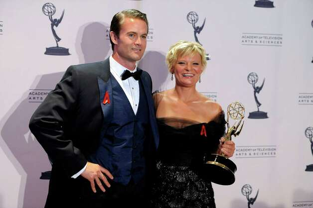 "Martha Plimpton, right, and Garret Dillahunt pose backstage with her award for outstanding guest actress in a drama series for playing Patti Nyholm on ""The Good Wife"" at the 2012 Creative Arts Emmys at the Nokia Theatre on Saturday, Sept. 15, 2012, in Los Angeles. (Photo by Chris Pizzello/Invision/AP) Photo: Chris Pizzello / Invision"