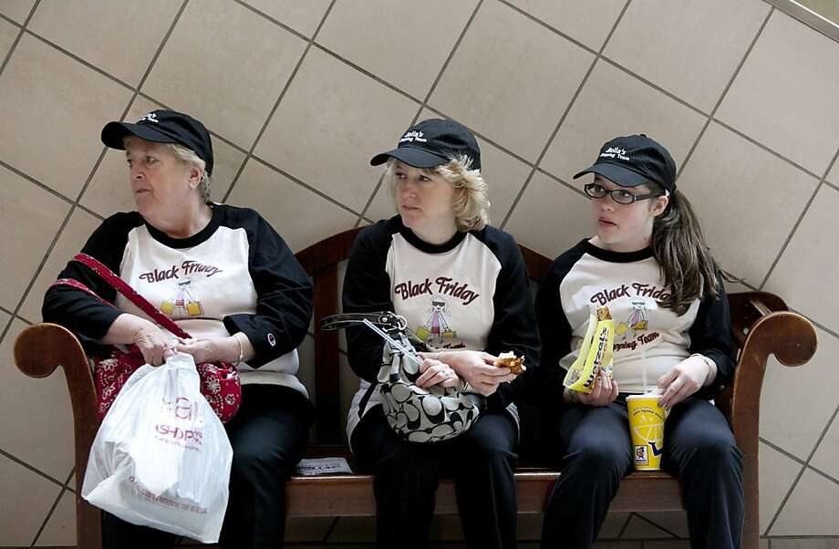 Team Black Fridayis up early for shopping deals at South Shore Plaza in Braintree, Mass. No doubt they wore their cleats in case they have to spike someone for the last $200 HD-TV. Photo: Allison Joyce, Getty Images