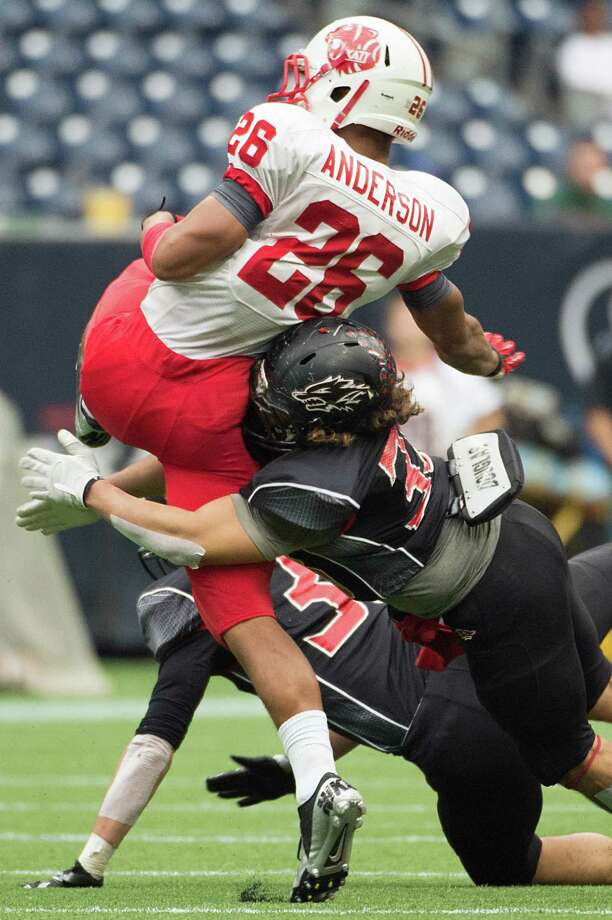 Katy running back Rodney Anderson (26) is hit by Langham Creek linebacker Jacob Holguin (33) during the first half in high school football playoff action at Reliant Stadium Friday, Nov. 23, 2012, in Houston. Photo: Smiley N. Pool, Houston Chronicle / © 2012  Houston Chronicle