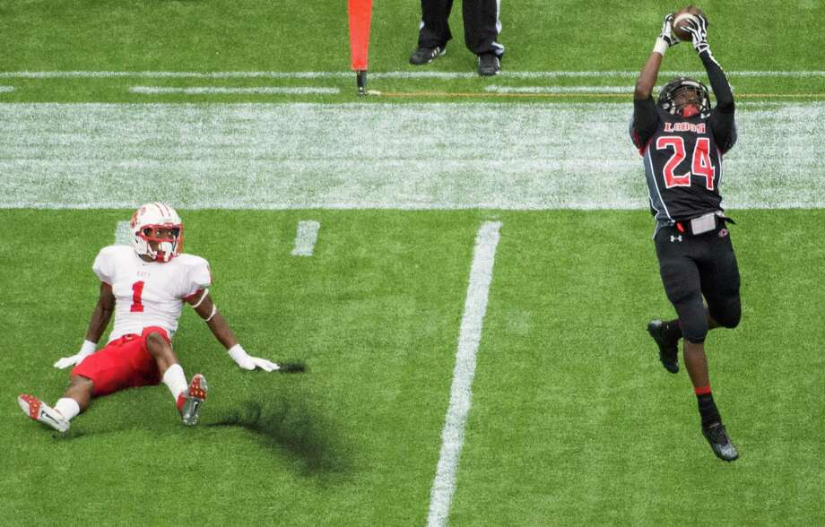 Langham Creek defensive back Jabari Salter (24) intercepts a pass intended for Katy receiver  Kyle Fulks (1) during the first half in high school football playoff action at Reliant Stadium Friday, Nov. 23, 2012, in Houston. Photo: Smiley N. Pool, Houston Chronicle / © 2012  Houston Chronicle