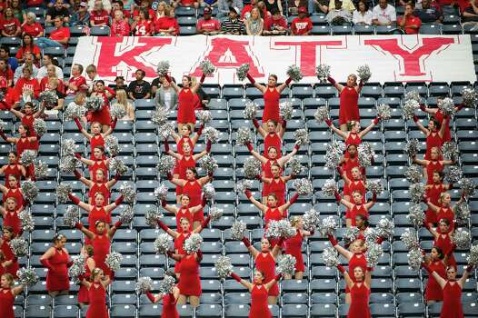 Members of the Katy drill team cheer from the stands during the first half in high school football playoff action against Langham Creek at Reliant Stadium Friday, Nov. 23, 2012, in Houston. Photo: Smiley N. Pool, Houston Chronicle / © 2012  Houston Chronicle