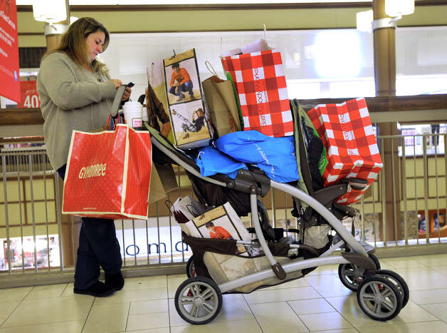 Theresa Giardiello, of Danbury, texts and Facebooks other shoppers to compare prices. She arrived at 2 a.m. at the Danbury Fair Mall with her sister, Donna, Black Friday, Nov. 23, 2012. Photo: Carol Kaliff / The News-Times