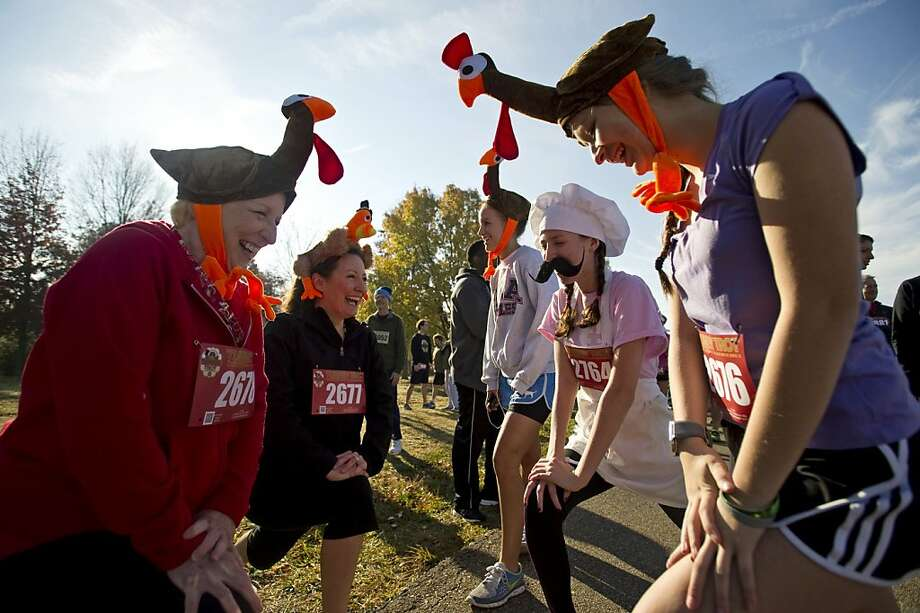 Tennessee's 4-mile gobble: Feathered hens and their culinary competition stretch before the annual Memphis Turkey Trot race at Shelby Farms. Photo: Brandon Dill, Associated Press
