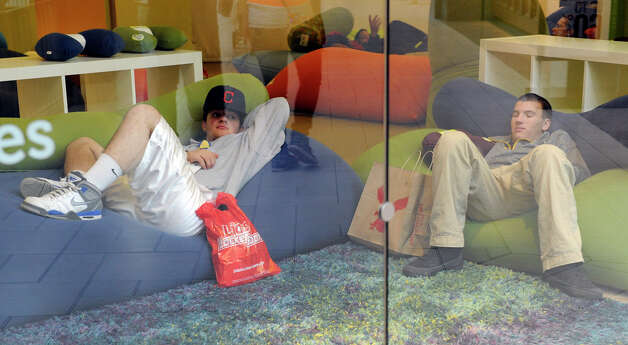 Rob Zullo, left, and Steven Gagas, both 17 and from Middlebury, rest on the couches in the Yogibo store at the Danbury Fair Mall, tired from early morning Black Friday shopping, Nov. 23, 2012. Photo: Carol Kaliff / The News-Times