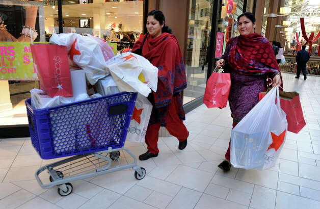 Nazia Asif, left, and her sister-in-law Nellam Zia, both of Danbury, have quite a haul of merchandise after just two hours of shopping. The pair arrived at the Danbury Fair Mall at 6:30a.m. to take advantage of Black Friday bargains, Nov. 23, 2012. Photo: Carol Kaliff / The News-Times