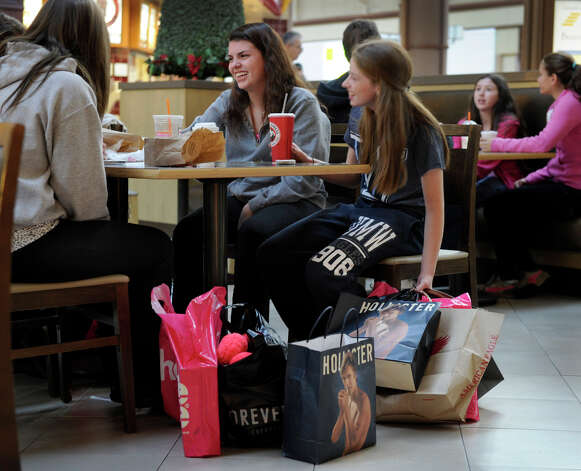 Shannon Spillane, 17, center, of Katonah, N.Y. and Victoria Lang, 16, of Bedford, N.Y., break for food while shopping at the Danbury Fair mall early morning, Black Friday, Nov. 23, 2012. Photo: Carol Kaliff / The News-Times