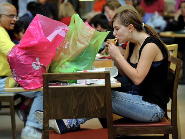 Kristina Maceira, 16, of Bethel, takes a break from Black Friday shopping to eat a burger and fries at the Danbury Fair mall, Nov. 23, 2012. Photo: Carol Kaliff / The News-Times