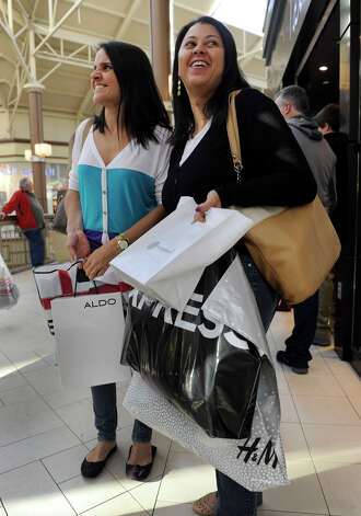 Nivia Fernandes, left, and Rosie Ramos, of Danbury, shop at the Danbury Fair mall, Black Friday, Nov. 23, 2012. Photo: Carol Kaliff / The News-Times