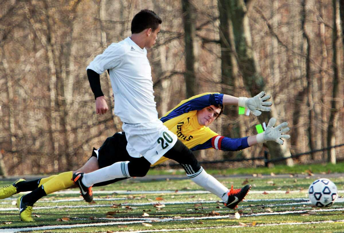 Norwalk high school's Nacho Navarro gets a shot by Fairfield Prep high school goalie William Steiner to score Norwalk's second goal in the CIAC class LL boys soccer championship game held at New Canaan high school, New Canaan, CT on Friday November 23rd, 2012