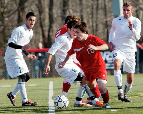 Fairfield Prep high school's David Bruton moves the ball upfield in the CIAC class LL boys soccer championship game against Norwalk high school held at New Canaan high school, New Canaan, CT on Friday November 23rd, 2012 Photo: Mark Conrad / Connecticut Post Freelance