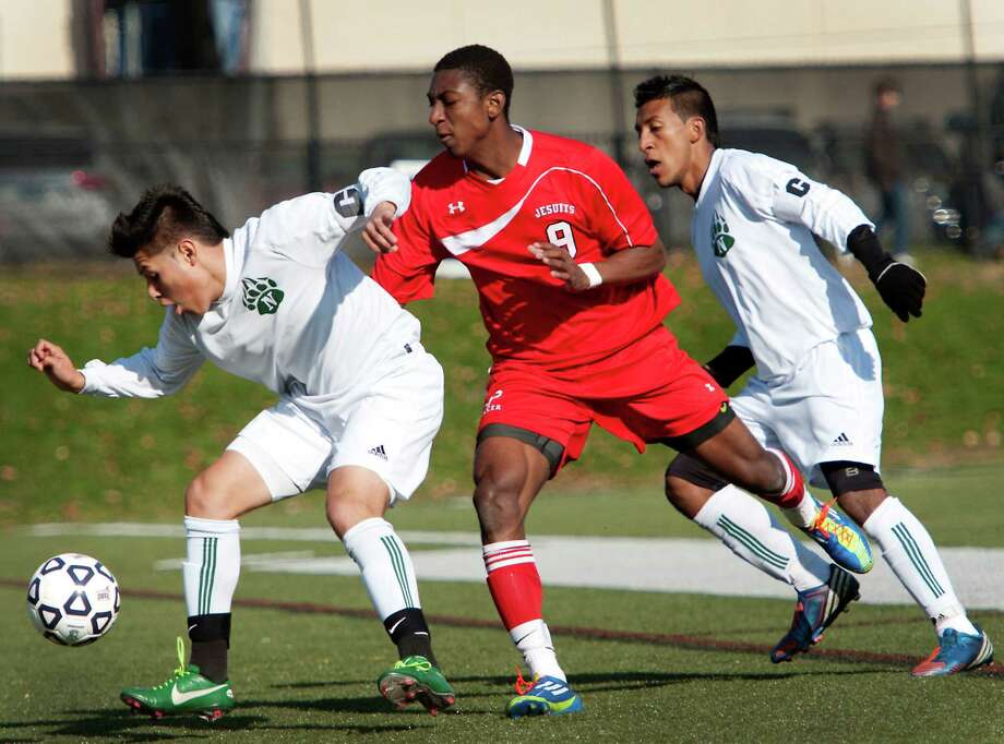 Norwalk high school's Alejandro Rivera and Fairfield Prep high school's Austin Sims battle for the ball in the CIAC class LL boys soccer championship game held at New Canaan high school, New Canaan, CT on Friday November 23rd, 2012 Photo: Mark Conrad / Connecticut Post Freelance