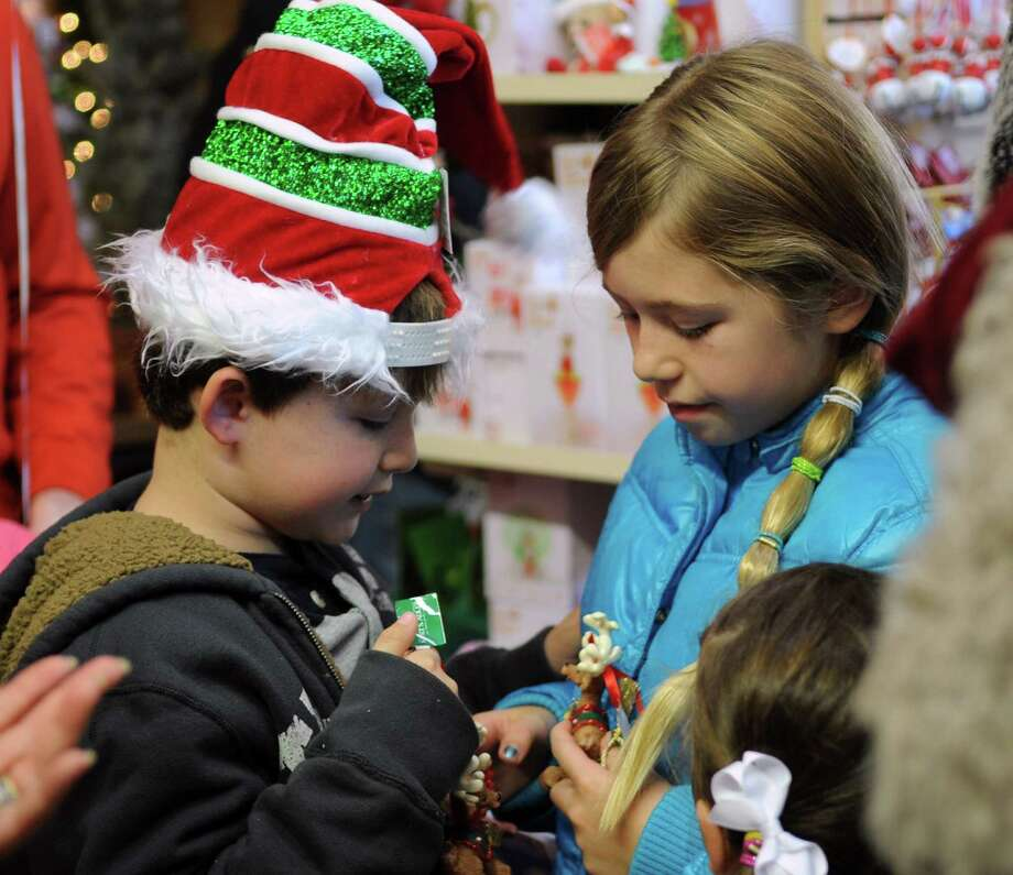 Trey Lawson, 7, and his sister, Lauren, 9, look at ornaments at McArdle's Florist and Garden Center in Greenwich on Friday, September 23, 2012, as part of the fourth annual Greenwich Reindeer Festival and Santa's Workshop, an event which ends Christmas Eve. Photo: Lindsay Niegelberg / Stamford Advocate