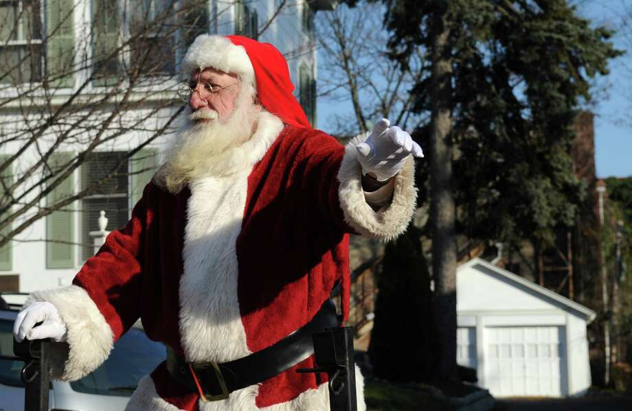 Santa Claus arrives at McArdle's Florist and Garden Center in Greenwich on Friday, September 23, 2012. Photo: Lindsay Niegelberg / Stamford Advocate