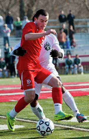 Fairfield Prep high school's Kieran Bracken battles for the ball in the CIAC class LL boys soccer championship game against Norwalk high school held at New Canaan high school, New Canaan, CT on Friday November 23rd, 2012 Photo: Mark Conrad / Connecticut Post Freelance