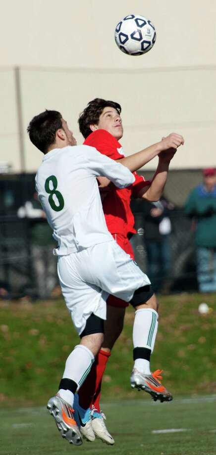 Norwalk high school's Matt Capomolla and Fairfield Prep high school's Nick Dosky go up to head the ball in the CIAC class LL boys soccer championship game held at New Canaan high school, New Canaan, CT on Friday November 23rd, 2012 Photo: Mark Conrad / Connecticut Post Freelance