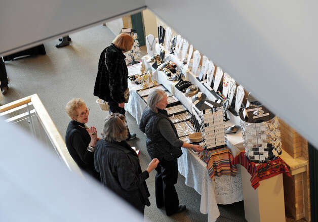 People browse the different vender tables at the Holiday Gift Fair at the Albany Institute of History & Art Friday, Nov. 23, 2012 in Albany, N.Y.  (Lori Van Buren / Times Union) Photo: Lori Van Buren