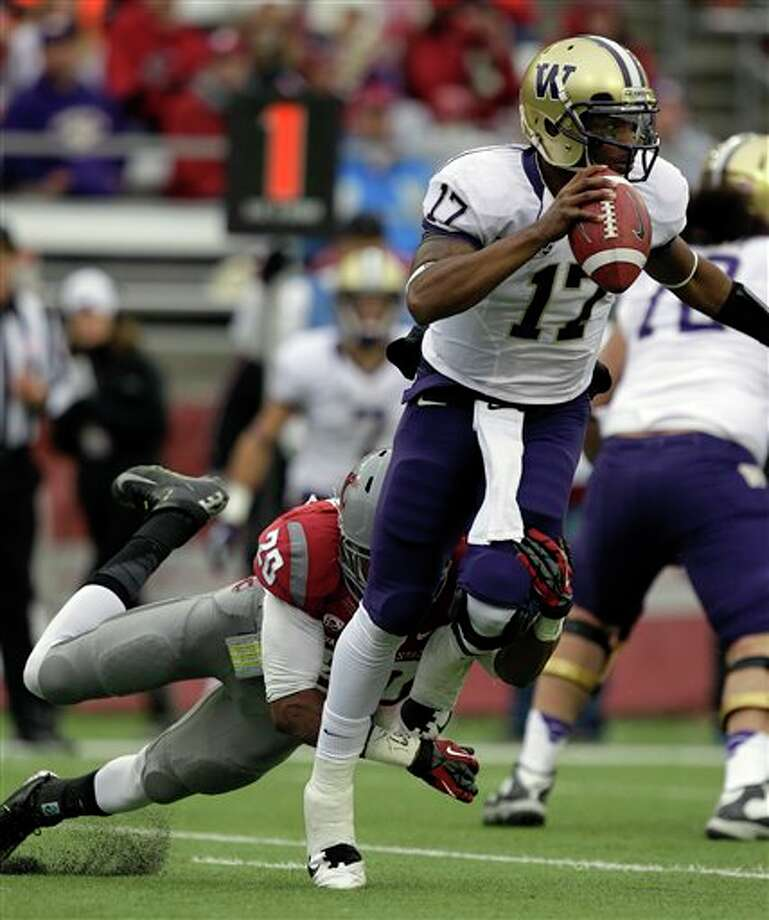 Washington quarterback Keith Price (17) is sacked by Washington State's Deone Bucannon (20) in the first half. Photo: Ted S. Warren, AP / AP