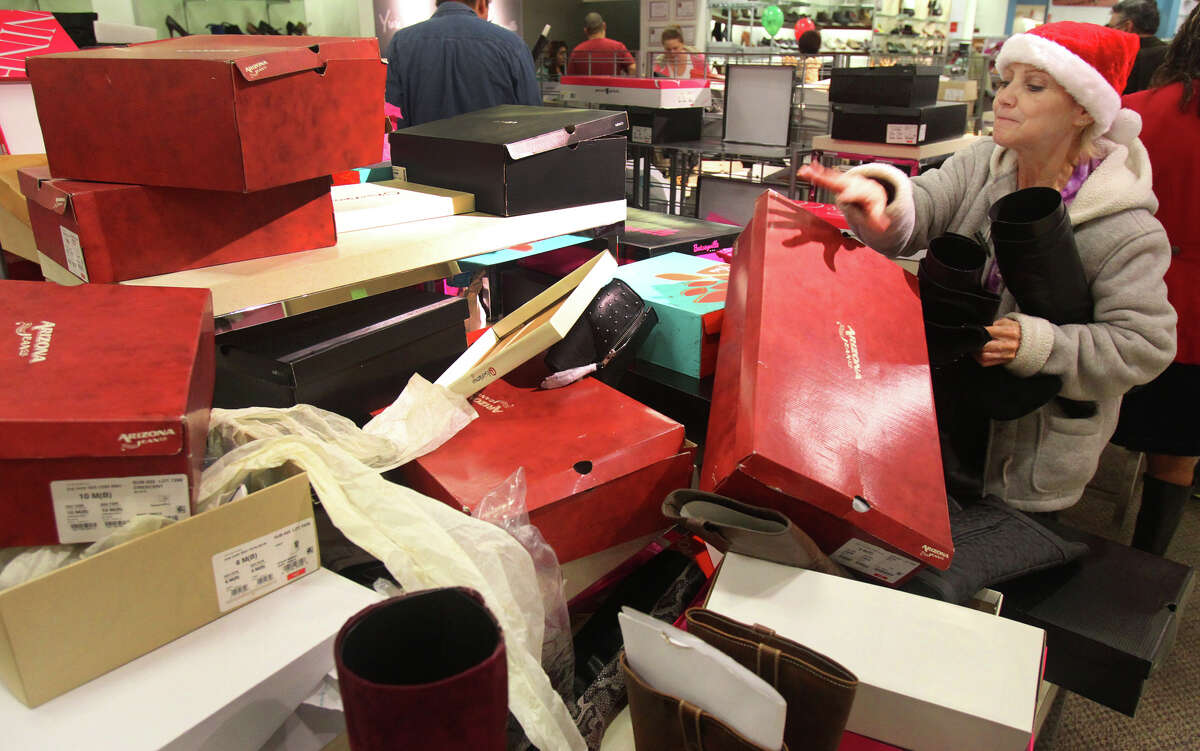 Rose Pena (right) sifts through a pile of shoe boxes looking for a boot that matches the one she was hoping to purchase at JC Penny at North Star Mall Black Friday November 23, 2012. Pena and other shoppers at the mall were taking advantage of Black Friday sales.