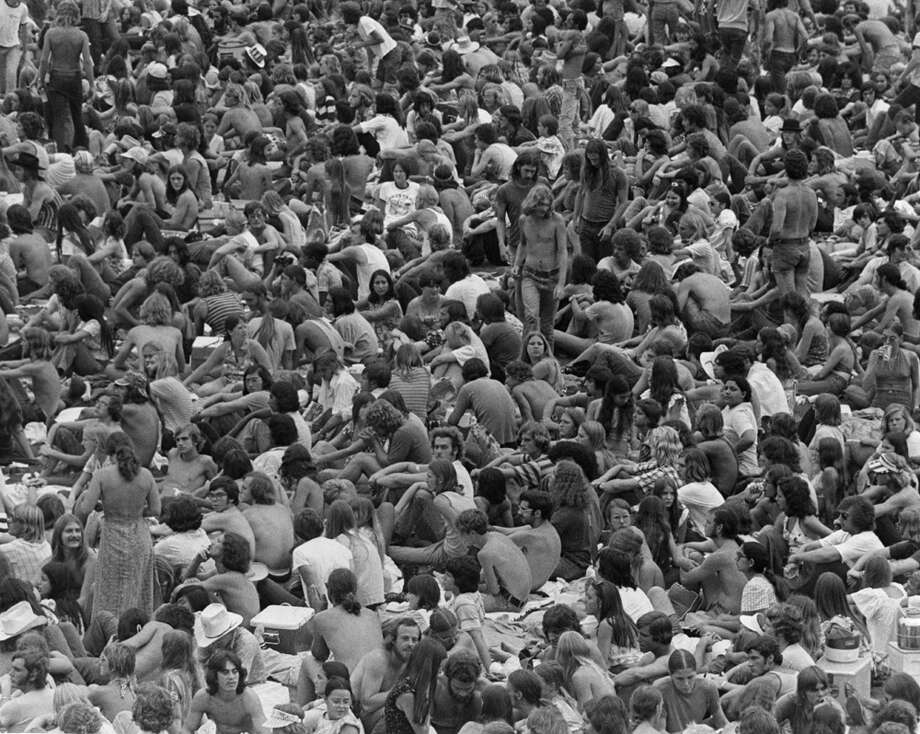 A sea of several thousand young people, undismayed by overcast and occasionally rainy weather Sunday, soaks up music and friendship at a non-stop rock festival at Jeppesen Stadium near the University of Houston. Highlighting the show were appearances by Willie Nelson, the Doobie Brothers, Savoy Brown, the Blue Oyster Cult and Wishbone Ash. August 12, 1973