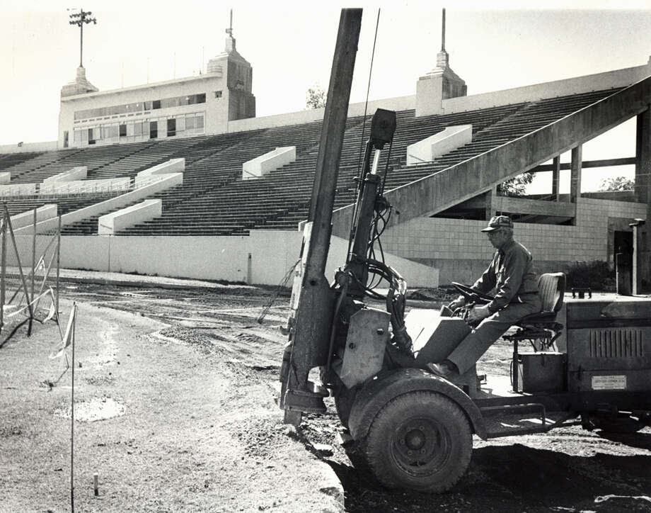 Photo taken Oct. 31, 1979: A little bit of Houston athletic history is disappearing in Robertson Stadium, where workmen are digging up the original cinder track that was first put down in 1942, when the place was Jeppesen Stadium and was a part of the Houston School District's first sports complex. The Houston high school city championships, the regionals, the University of Houston Meet of Champions, Texas Southern Relays and Houston Invitational were among the major events held annually on the old cinder track. UH will replace the old track with a nine-lane, 400-meter, all-weather surface. Photo: Dan Hardy, Houston Post / Post file