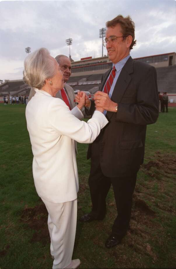 John O'Quinn, right, and Wilhelmina Robertson Smith shake hands after the groundbreaking ceremonies at Robertson Stadium, which will be renamed, O'Quinn Field at Robertson Stadium. (Karen Warren / Houston Chronicle)