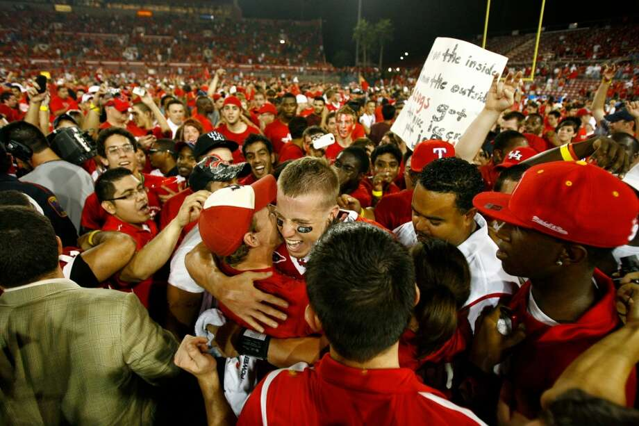 Houston quarterback Case Keenum is mauled by the crowd after Houston beat Texas Tech 29-28  Sunday, Sept. 27, 2009, at Robertson Stadium in Houston. (Nick de la Torre / Houston Chronicle)