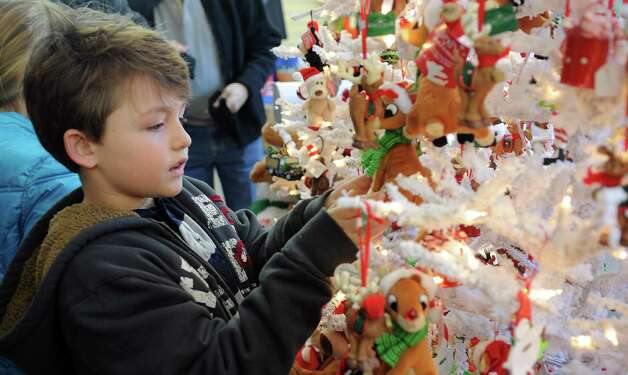 Trey Lawson, 9, looks at ornaments at McArdle's Florist and Garden Center in Greenwich on Friday, September 23, 2012, as part of the fourth annual Greenwich Reindeer Festival and Santa's Workshop, an event which ends Christmas Eve. Photo: Lindsay Niegelberg / Stamford Advocate