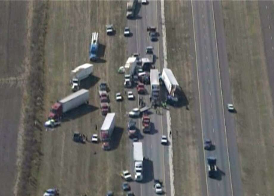 In this image provided by Click2houston.com cars and trucks are piled on Interstate 10 in Southeast Texas Thursday Nov. 22, 2012.  The Texas Department of Public Safety says at least 35 people have been injured in a more than 50-vehicle pileup. (AP Photo/Click2houston.com) MANDATORY CREDIT
