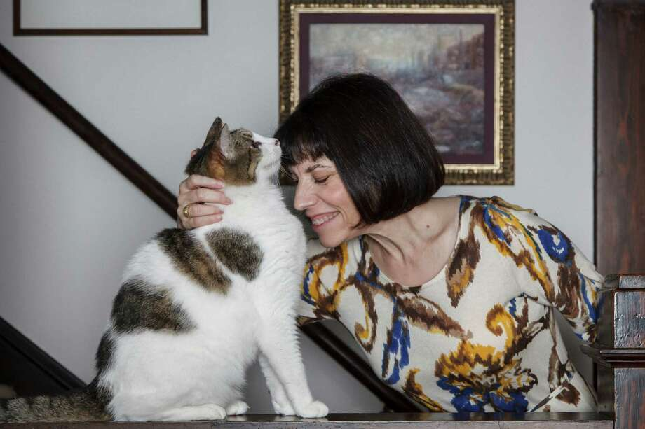 "Diane Lovejoy, author of the new book ""Cat Lady Chronicles,"" pets her cat Alvar in her home, Thursday, Nov. 1, 2012, in Houston. ( Michael Paulsen / Houston Chronicle ) Photo: Michael Paulsen, Staff / © 2012 Houston Chronicle"