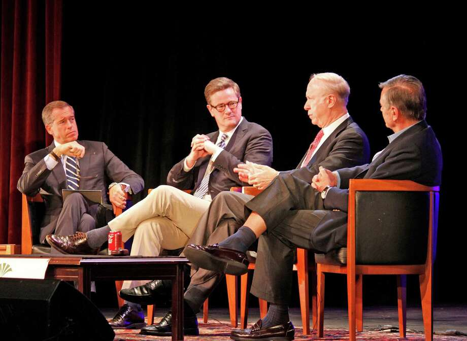 At the annual Richard Salant Lecture at New Canaan High School on Sunday, Nov. 18, NBC's Brian Williams, a resident of New Canaan; MSNBC's Joe Scarborough; CNN's David Gergen; and Peter Goldmark, an environmentalist and advocate for social causes, discuss post-election issues. Photo: Contributed