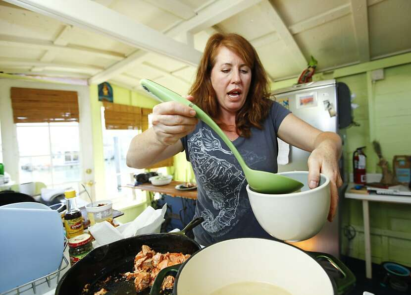 Maria Finn ladles salmon-head soup on her Sausalito houseboat, demonstrating the appeal of making us