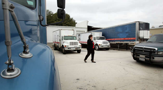 Maria de Lourdes Sobrino, founder and CEO of Lulu's Dessert Corp., takes a call as she walks across the loading zone of the site she purchased in San Antonio. Photo: Bob Owen, San Antonio Express-News / © 2012 San Antonio Express-News