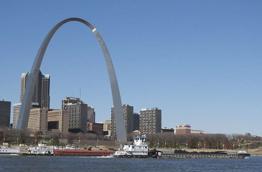 FILE - In this Nov. 12, 2012 file photo, two barges head north on the Mississippi River past St. Lou