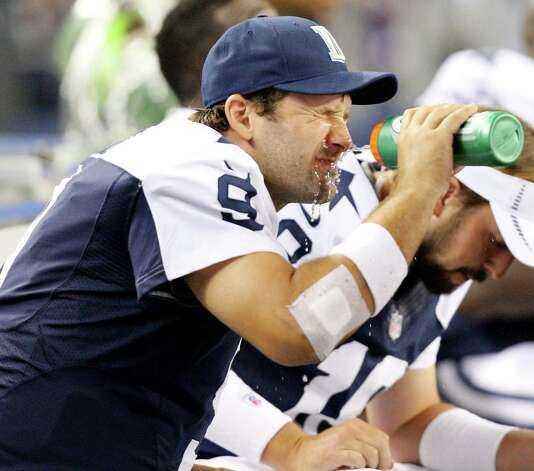 Dallas Cowboys' Tony Romo squirts water on his face while on the bench  during second half action against the Washington Redskins Thursday Nov. 22, 2012 at Cowboys Stadium in Arlington, Tx.  The Redskins won 38-31. Photo: Edward A. Ornelas, San Antonio Express-News / © 2012 San Antonio Express-News