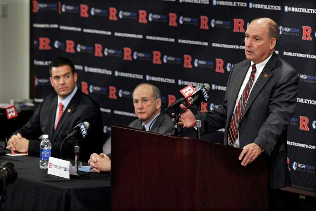 Rutgers Director of Intercollegiate Athletics Tim Pernetti, left, and Rutgers President Robert Barchi listen Tuesday, Nov. 20, 2012, in Piscataway, N.J., as Big Ten Commissioner Jim Delany, right, announces that Rutgers will join the Big Ten. Rutgers is joining the Big Ten, leaving the Big East behind and cashing in on the school's investment in a football program that only 10 years ago seemed incapable of competing at the highest level. (AP Photo/Mel Evans) Photo: Mel Evans, Associated Press / AP