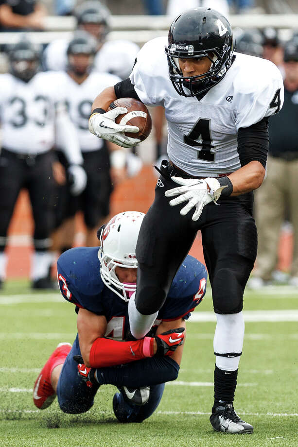 Steele's Justin Stockton tries to shake a leg tackle by Roosevelt's Jonathan Leos during the first quarter of their Class 5A Division II second round playoff game at Heroes Stadium on Nov. 23, 2012.  Stockton scored two touchdowns to help the Knights come away with a 45-0 victory over the Rough Riders.  MARVIN PFEIFFER/ mpfeiffer@express-news.net Photo: MARVIN PFEIFFER, Express-News / Express-News 2012