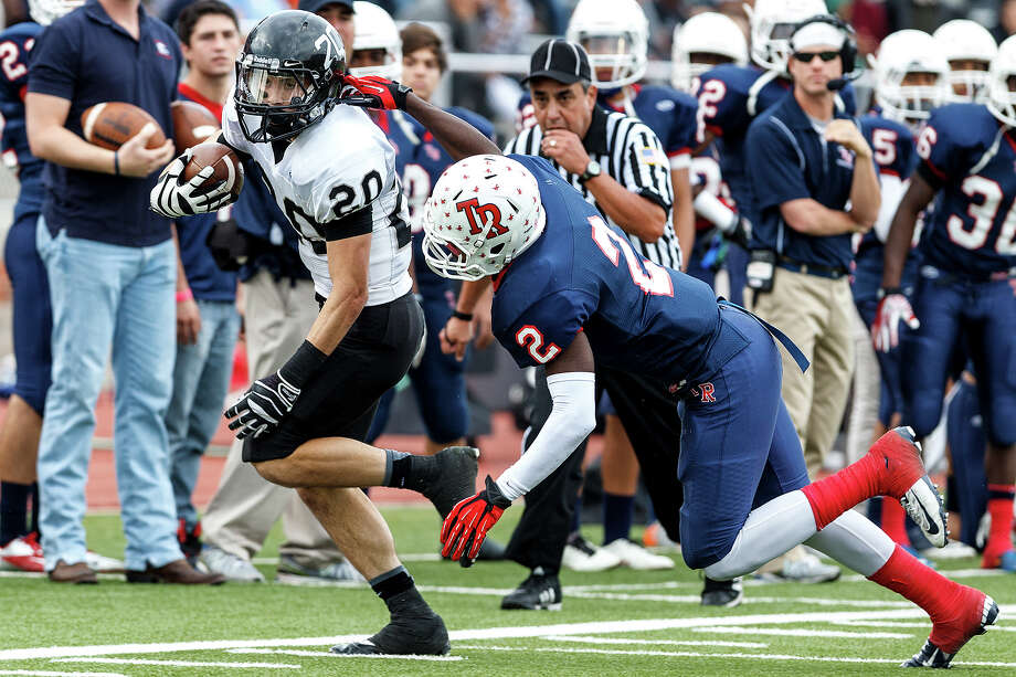 Steele's Matthew Mayle (left) tries to elude the grasp of Roosevelt's Jakorey Davis during the second quarter of their Class 5A Division II second round playoff game at Heroes Stadium on Nov. 23, 2012. Mayle scored three touchdowns to help the Knights come away with a 45-0 victory over the Rough Riders.  MARVIN PFEIFFER/ mpfeiffer@express-news.net Photo: MARVIN PFEIFFER, Express-News / Express-News 2012